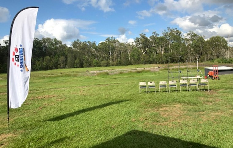 grass area with chairs and flags